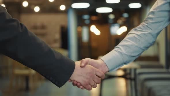 Close Up of Businessmen Handshake