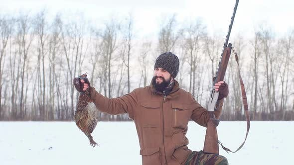 Thumbnail for Young Active Hunter Showing His First Fowl