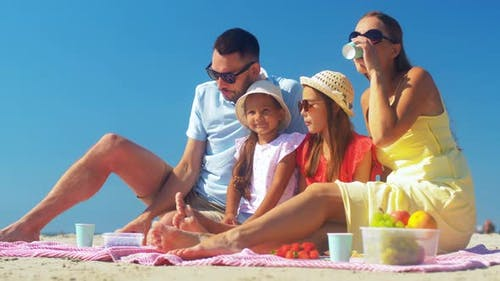 Happy Family Taking Selfie on Summer Beach