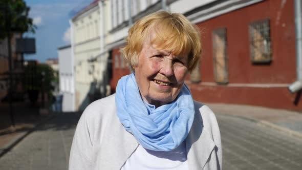 Thumbnail for Elderly Woman Smiling Portrait Outdoors