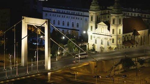 Evening view of Chain Bridge and illuminated Saint Stephen's Basilica, Hungary