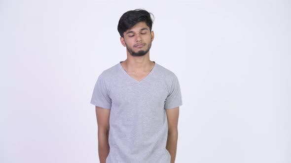 Thumbnail for Young Happy Bearded Indian Man Giving Gift Box