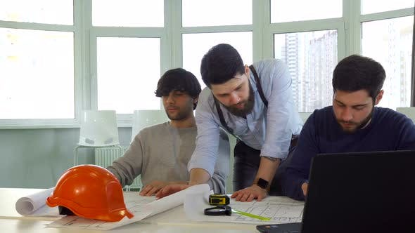 Thumbnail for Architect Showing His Coworker Something on the Plans