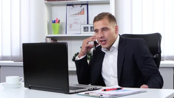 Thumbnail for Businessman Talking on the Phone and Nervous