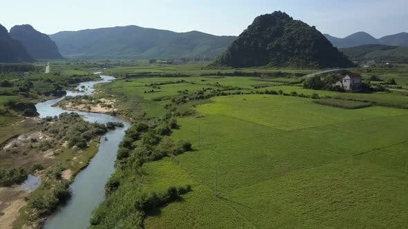 Thumbnail for Aerial View Rural Landscape with Fields River Houses By Hill