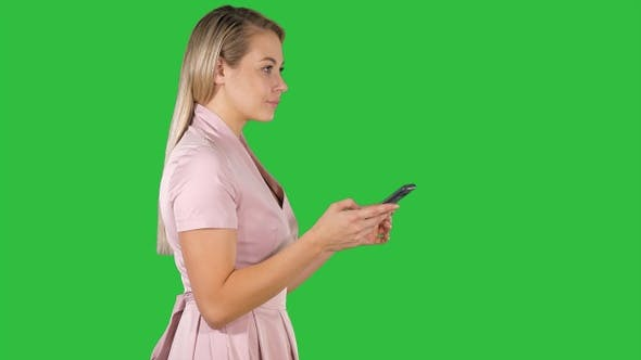 Thumbnail for Pretty Woman in Pink Dress Texting on Smart Phone on A