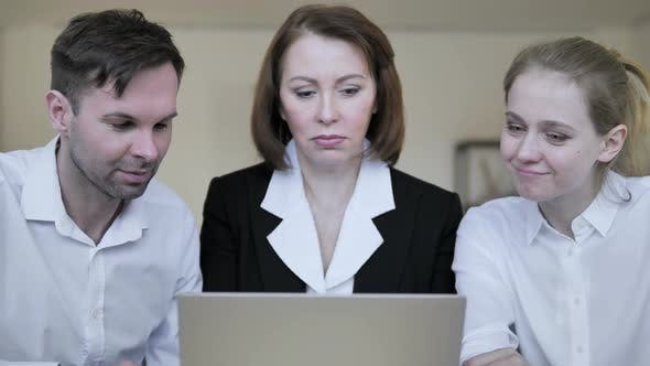 Thumbnail for Business People Working on Laptop Together