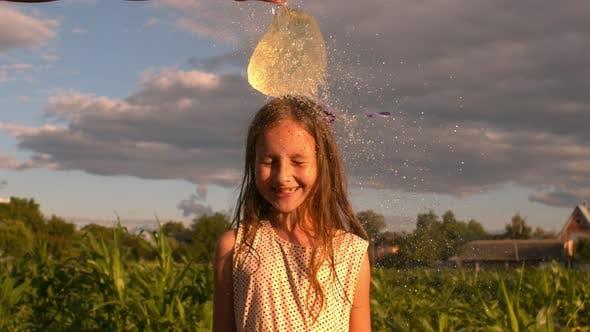 Water Balloon Splash On Little Head Of A Girl 4K