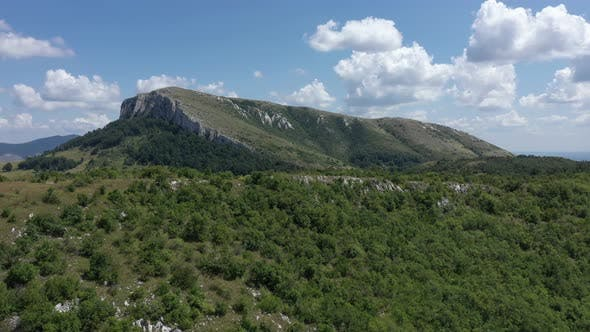 Flying above the valley under Stol mountain in Eastern Serbia 4K drone video