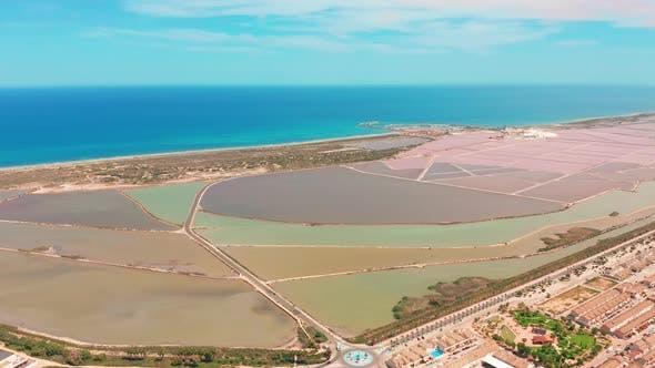Multicolored Salt Lakes with Coastal Salt Marshes