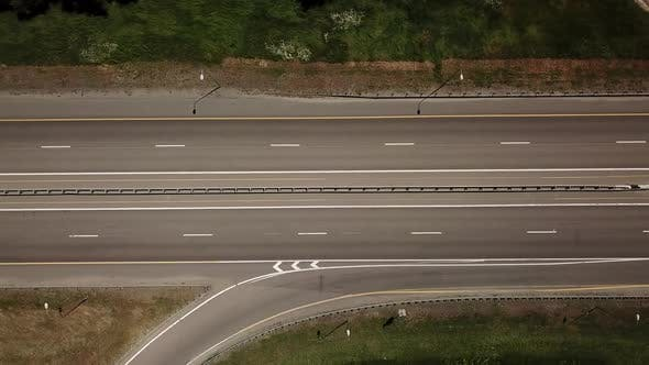 Thumbnail for Top Down Flyover View of Highway Intersection Car Bridge and Moving Cars