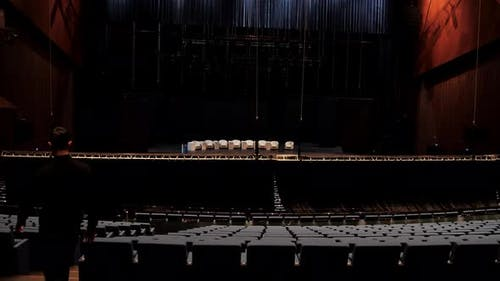 Man inside empty concert hall