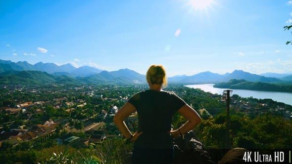 Thumbnail for 4K Back View of Woman Enjoying Landscape Viewpoint of Luang Prabang, Laos