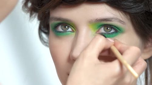 Young Woman with Green Eyeshadow.