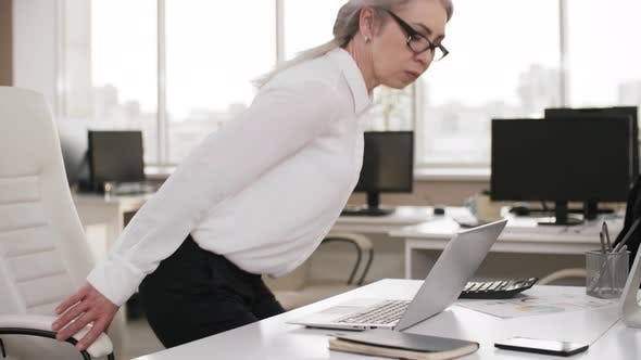 Thumbnail for Middle-Aged Female Lawyer Working Overtime Alone in Office