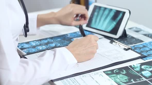 Thumbnail for Doctor Radiologist Looks X Ray Using Tablet
