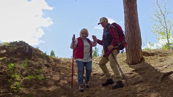 Cover Image for Active Pensioners Climbing Down Hill Together