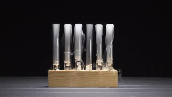 Smoky Glass Test Tubes with Dry Ice on a Black Background