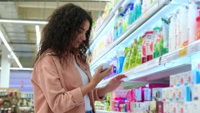 Woman Buying Body Care Products in the Supermarket