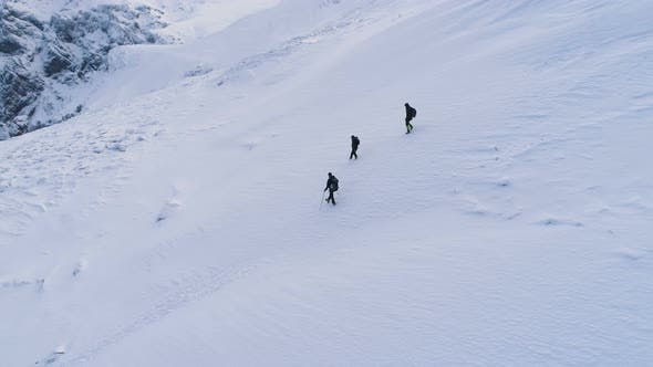 Thumbnail for A Group Of Tourists Descends From The Top Of A Snow Covered Mountain