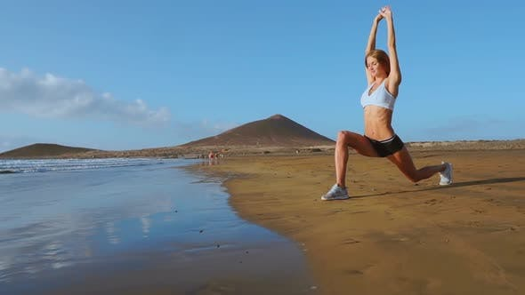 Thumbnail for Woman Doing Leg Stretches. Fitness Girl Stretching Legs on Beach Training. SLOW MOTION STEADICAM