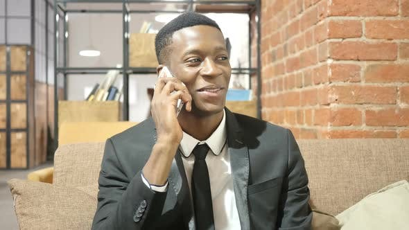 Thumbnail for Black Businessman Talking On Smartphone
