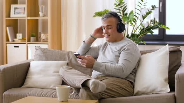 Thumbnail for Man with Smartphone and Headphones at Home