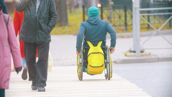 Thumbnail for Disabled Man in Wheelchair Crossing the Road at the Daylight
