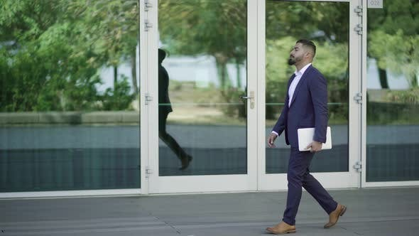 Thumbnail for Handsome Bearded Businessman Walking with Laptop on Street