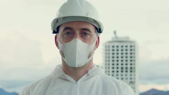Portrait of a Professional Engineer of a Construction Industrial Company Wearing a Protective Mask