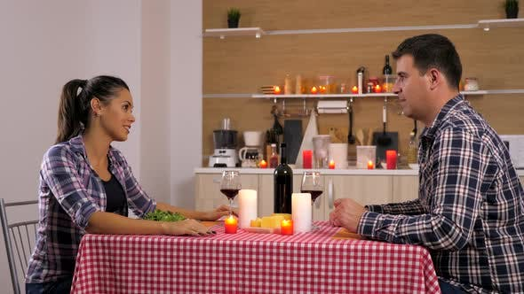 Pretty Couple Having Candle Light Dinner