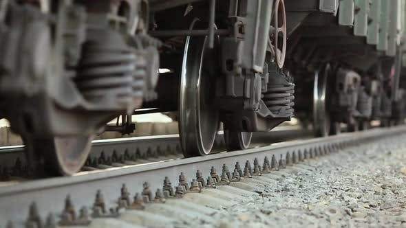 Thumbnail for The Wheels of Old Train on the Railway Track Passing By Camera. Close Up Shot