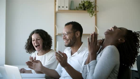 Cover Image for Group of Successful Workers Talking and Pointing at Laptop