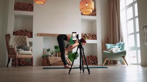 Athletic Woman is Filming Her Fitness Video Blog