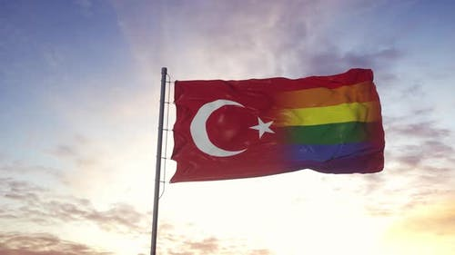 Waving national flag of Turkey and LGBT rainbow flag background