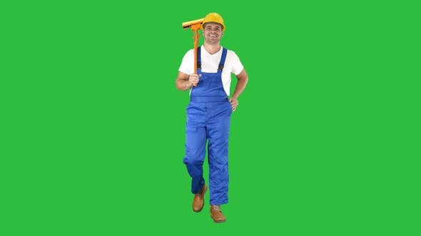 Thumbnail for Housecleaner in helmet walking with a mop on a Green Screen