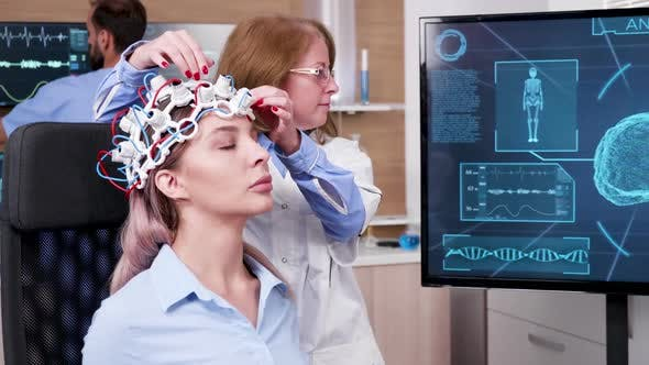 Female Doctor in Brain Science Lookin at Tv Screen
