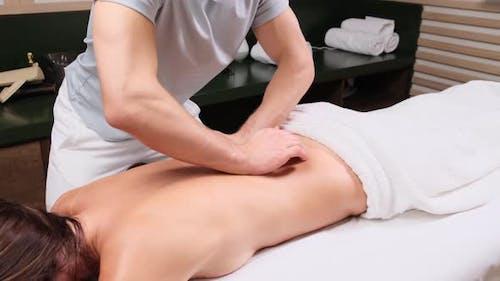 Masseur is doing massage