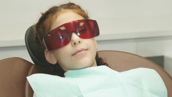 Thumbnail for On the Happy Girl Wearing Special Glasses That Protect Her Eyes