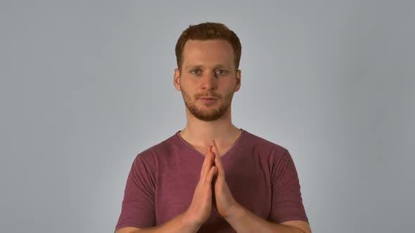 Ginger Male Shows Sign Namaste