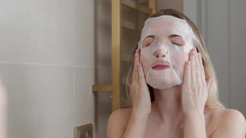 Young Woman Doing Purifying Mask on Her Face
