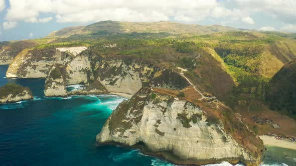 Thumbnail for Atuh Beach on Nusa Penida Island with a Lone Cliff Top House in Bali, Indonesia. Aerial View