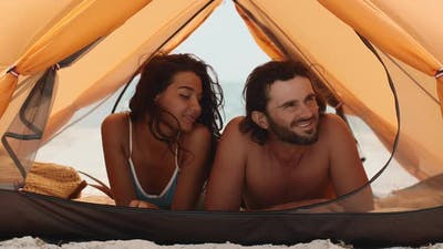 Couple on the Beach in a Tent