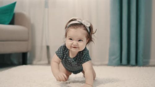 Baby Girl Crawling on All Fours on Floor at Home