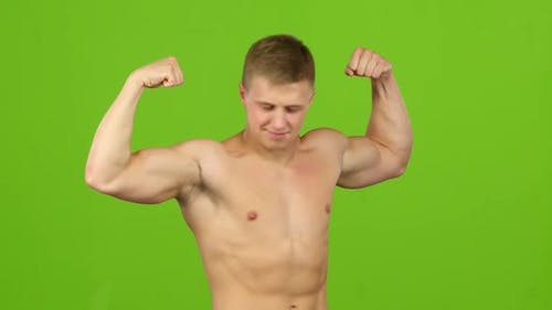 Man Strains Muscles and Shows Results of Training, Green Screen