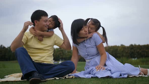 Thumbnail for Lovely Asian Family with Siblings Relaxing at Park