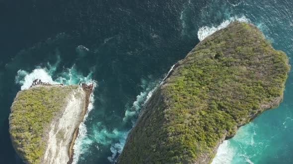 Thumbnail for Top down aerial view of dramatic sea cliffs and a rough ocean