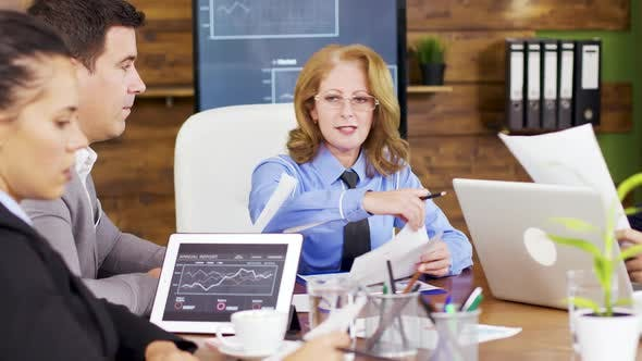 Thumbnail for Corporate Female Business Trainer Discussing Financial Graph