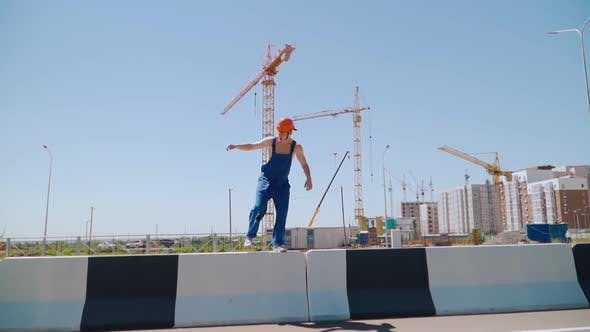 Thumbnail for Happy Caucasian Man Builder in Hard Hat Dancing. Worker Funny Moves Background Construction Site.