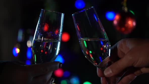 Thumbnail for New Year Celebration with Two Clinking Champagne Glasses